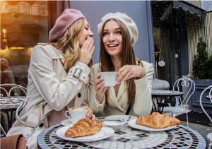women with dermaplaning eating croissants