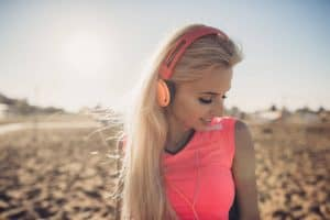 woman listening to music at beach